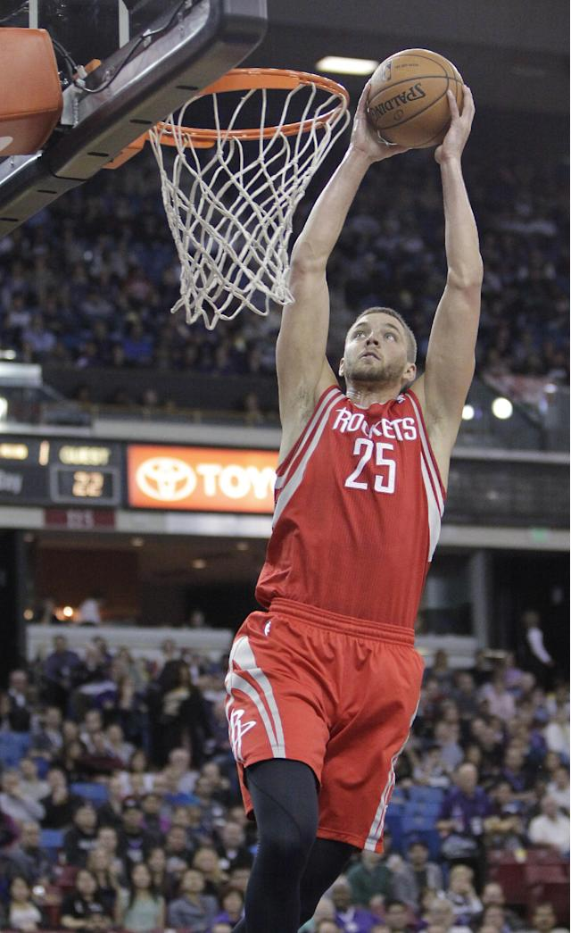 Houston Rockets forward Chandler Parsons goes up for a shot against the Sacramento Kings during the first quarter of an NBA basketball game in Sacramento, Calif., Tuesday Feb. 25, 2014. (AP Photo/Rich Pedroncelli)