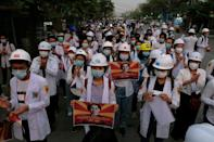 Medical staff and students took part in an early morning protest against the military coup in Mandalay