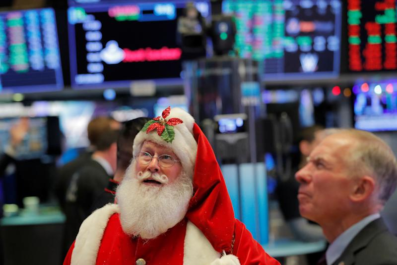 An actor dressed as Santa Claus visits the floor of the New York Stock Exchange shortly after the opening bell in New York, U.S., December 5, 2019. REUTERS/Lucas Jackson