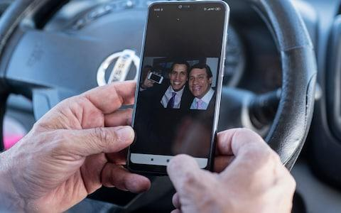 <span>Wilmer Guaido shows looks at a picture of his son Juan and his brother </span> <span>Credit: Simon Townsley </span>