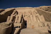 The colossal statues of a seated Ramses II at the entrance of Abu Simbel archaeological site, rescued from the waters of the reservoir behind the Aswan Dam