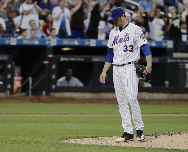 A frustrated Matt Harvey reacts Kyle Schwarber's two-run home run during Wednesday's game at Citi Field. (AP)