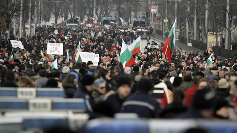 """Bulgarians block the traffic at main road juncture during a protest against higher electricity and heating bills, in Sofia, Sunday, Feb. 17, 2013. Thousands of angry Bulgarians chanted """"mafia"""" and """"resignation"""" demanded the expulsion of the three foreign-controlled power distributors that control the local market: Czech Republic's CEZ and Energo-Pro, and Austria's EVN (AP Photo/Valentina Petrova)"""