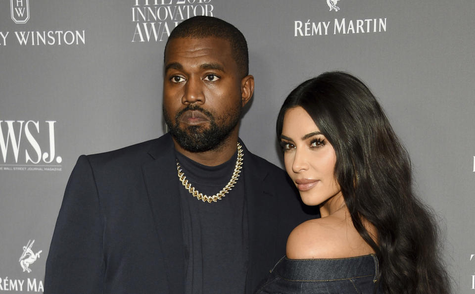 FILE - Kanye West, left, and Kim Kardashian attend the WSJ. Magazine Innovator Awards on Nov. 6, 2019, in New York. Kim Kardashian West filed for divorce Friday, Feb. 19, 2021, from Kanye West after 6 1/2 years of marriage. Sources familiar with the filing but not authorized to speak publicly confirmed that Kardashian filed for divorce in Los Angeles Superior Court. The filing was not immediately available. (Photo by Evan Agostini/Invision/AP, File)