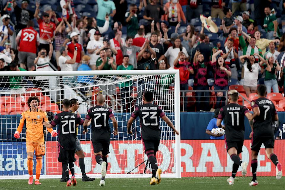 DENVER, COLORADO - JUNE 03: Goalie Guillermo Ochoa #13 of Mexico celebrates with his teammates after saveing a shot goal by Allan Cruz of Costa Rica to win on penalty kicks during Game 2 of the Semifinals of the CONCACAF Nations League Finals of at Empower Field At Mile High on June 03, 2021 in Denver, Colorado. (Photo by Matthew Stockman/Getty Images)