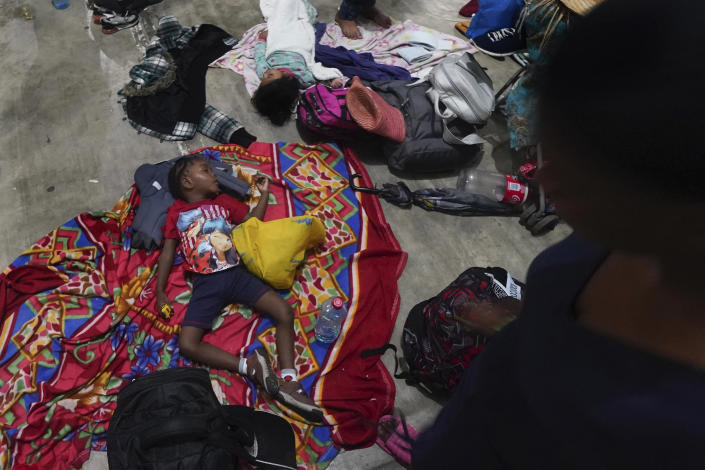 Migrants who were part of a caravan heading north, stop to rest in Huixtla, Chiapas state, Mexico, Sunday, Sept. 5, 2021. (AP Photo/Marco Ugarte)