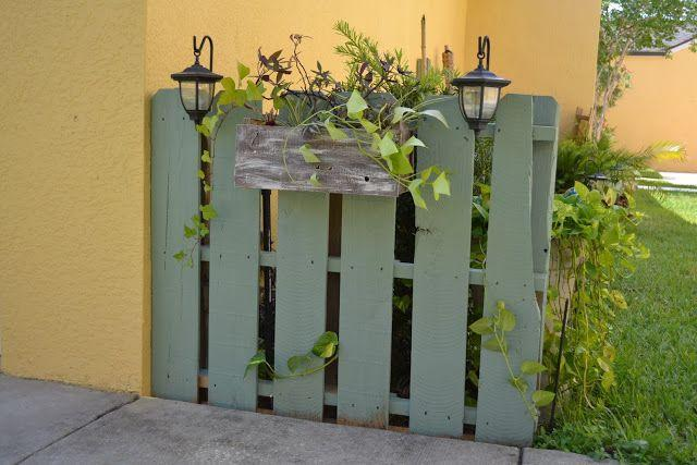 "<p>This little painted fence, built from an old pallet, is more of a divider than a privacy screen. However, it provides an attractive transition from walk to garden. The planter, also made from scrap pallet wood, finishes the look.</p><p><strong>Get the tutorial at <a href=""https://camelotartcreations.blogspot.com/2011/06/garden-pallet.html#.Xs05zy2ZNDD"" rel=""nofollow noopener"" target=""_blank"" data-ylk=""slk:Camelot Art Creations"" class=""link rapid-noclick-resp"">Camelot Art Creations</a>.</strong></p><p><a class=""link rapid-noclick-resp"" href=""https://go.redirectingat.com?id=74968X1596630&url=https%3A%2F%2Fwww.homedepot.com%2Fp%2FBEHR-ULTRA-1-qt-T18-15-In-The-Moment-Satin-Enamel-Exterior-Paint-and-Primer-in-One-985404%2F311069451&sref=https%3A%2F%2Fwww.thepioneerwoman.com%2Fhome-lifestyle%2Fgardening%2Fg32651791%2Fdecorative-garden-fence-ideas%2F"" rel=""nofollow noopener"" target=""_blank"" data-ylk=""slk:SHOP EXTERIOR PAINT"">SHOP EXTERIOR PAINT</a></p>"