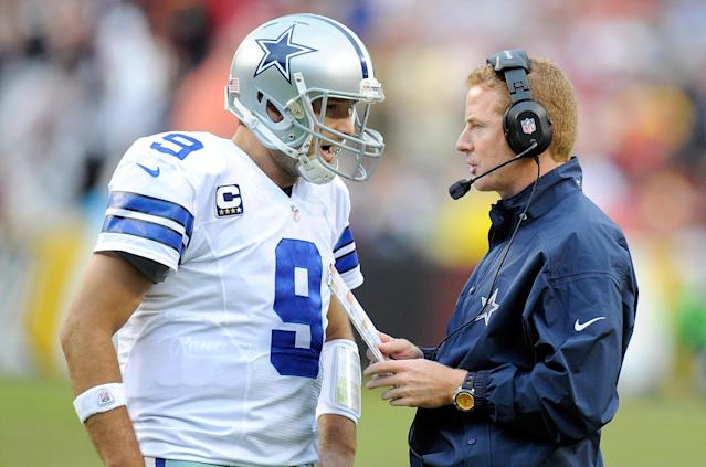 LANDOVER, MD - DECEMBER 22: Head coach Jason Garrett of the Dallas Cowboys talks with Tony Romo #9 during a timeout in the fourth quarter against the Washington Redskins at FedExField on December 22, 2013 in Landover, Maryland. Dallas won the game 24-23. (Photo by Greg Fiume/Getty Images)