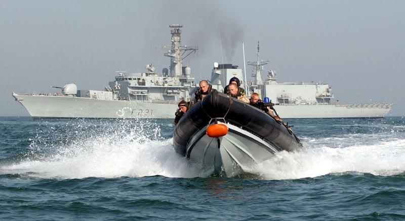 A Royal Marine boarding team trains in front of the HMS Argyll on March 24, 2007