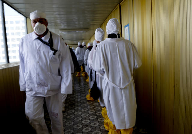 <p>Workers in protective suits walk through a passage at the Chernobyl nuclear plant, in Chernobyl, Ukraine, Friday, April 20, 2018. (Photo: Efrem Lukatsky/AP) </p>