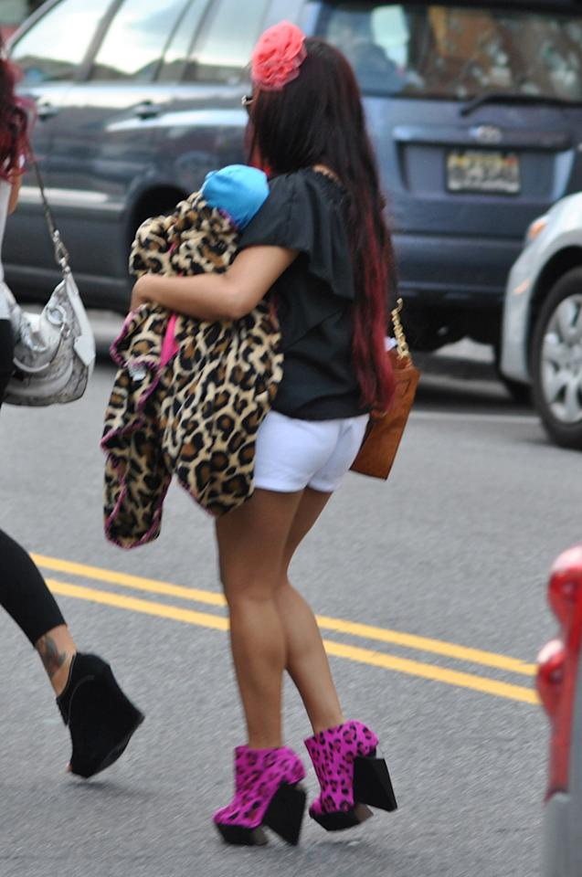 <p>Snooki sported hot pink leopard-print heels while carrying a  fake baby doll on March 22, 2012 in Jersey City, New Jersey.</p>