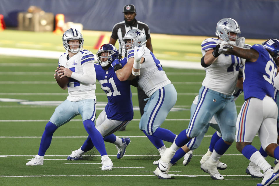 Oct 11, 2020; Arlington, Texas, USA; Dallas Cowboys quarterback Andy Dalton (14) looks to throw from the pocket in the fourth quarter against the New York Giants at AT&T Stadium. Mandatory Credit: Tim Heitman-USA TODAY Sports