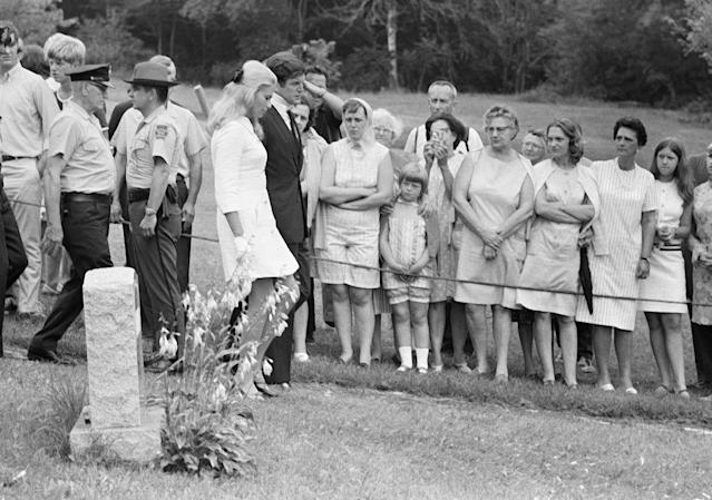 <p>Sen. Edward M. Kennedy, and his wife, Joan, pass a tombstone as they attend the burial of Mary Jo Kopechne, a former aide of slain Sen. Robert F. Kennedy on July 22, 1969 in Plymouth, Pa. (Photo: AP) </p>