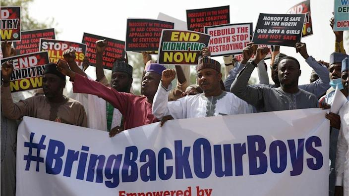 """Supporters of the """"Coalition of Northern Groups"""" (CNG) rally to urge authorities to rescue hundreds of abducted schoolboys, in northwestern state of Katsina, Nigeria on December 17, 2020 -"""