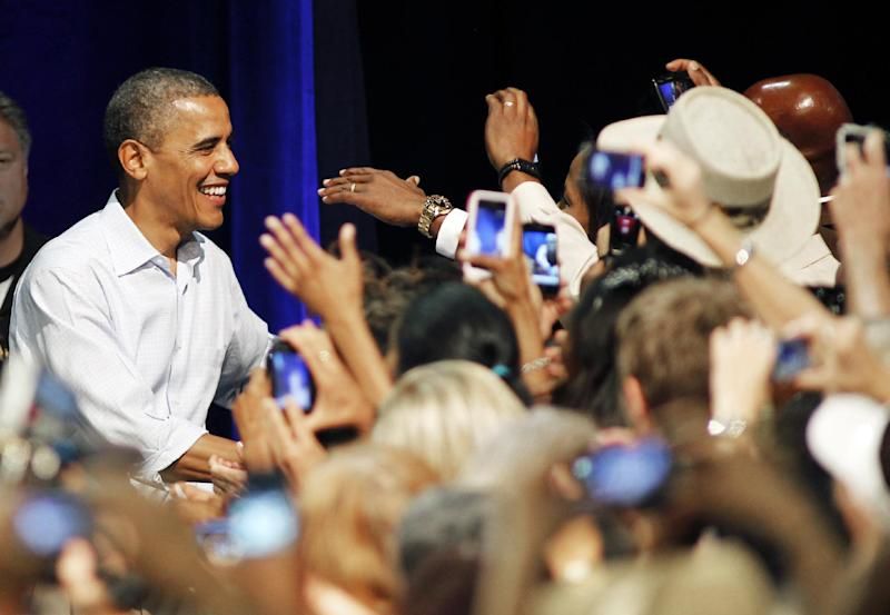 President Barack Obama greets supporters at the Palm Beach County Convention Center in West Palm Beach, Fla., during a campaign stop Sunday, Sept. 9, 2012. (AP Photo/Terry Renna)