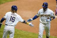 Milwaukee Brewers' Manny Pina is congratulated by Ben Gamel after hitting a home run during the fifth inning of a baseball game against the Minnesota Twins Tuesday, Aug. 11, 2020, in Milwaukee. (AP Photo/Morry Gash)