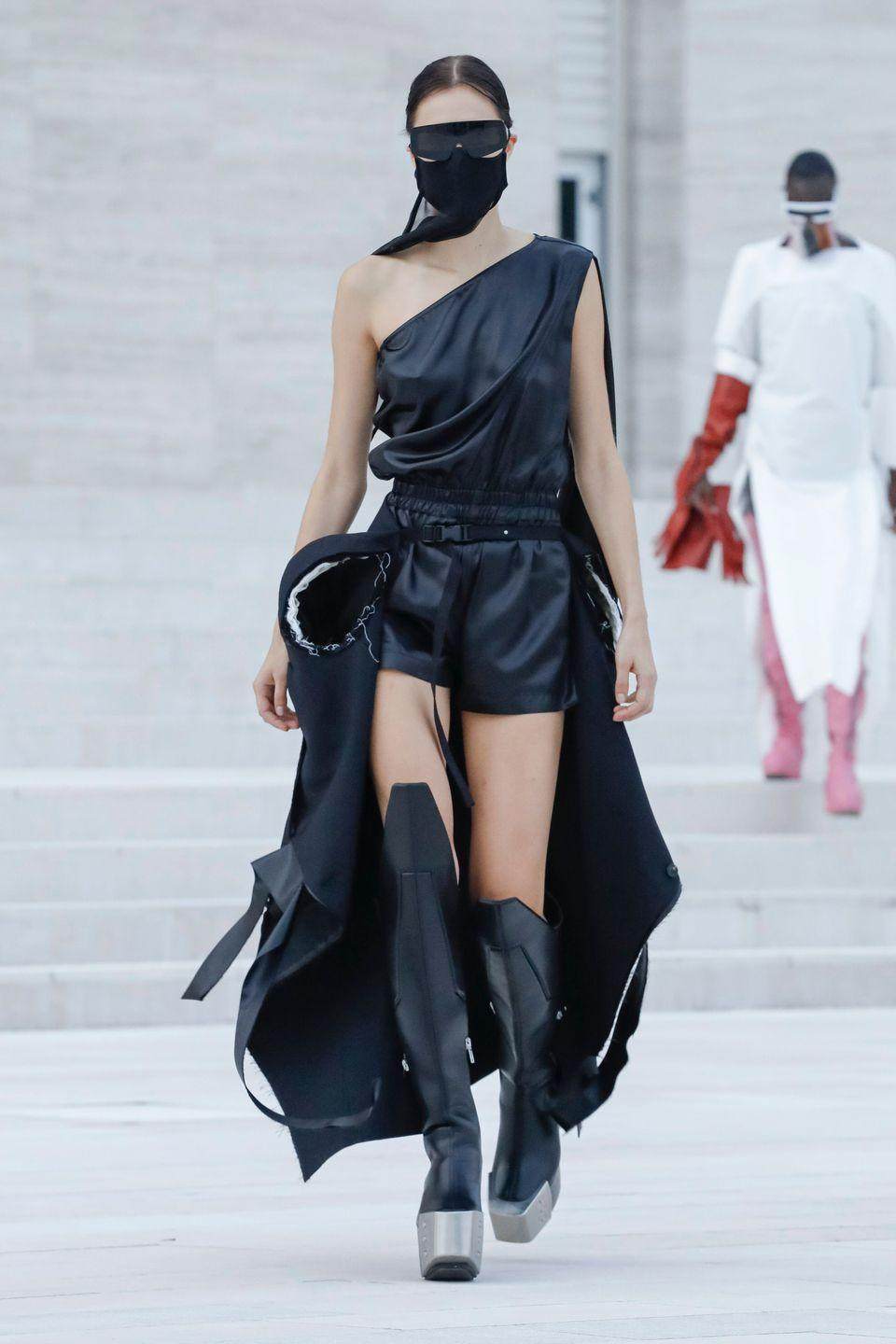 <p>Rick Owens's spring 2021 show reached mythic proportions in more ways than one. He titled the collection Phlegethon after one of the five rivers of the Underworld in Greek mythology (and the river of blood in Dante's <em>Divine Comedy</em>)<em>.</em> And his lineup of tops and capes with linebacker shoulders; rigid, cocoon-like ponchos; and thigh-high platform leather boots was a showcase of sartorial exaggeration. It conveyed a sense of hell on earth, the Twilight of the Gods—or in this case, of humanity. Indeed, Owens is no stranger to postapocalyptic ideas (darkness, in both the literal and figurative sense, is embedded in his brand), and in the era of COVID-19, this dystopian display felt reflective of our times. To wit: Every look featured a face mask. —<em>Barry Samaha</em></p>