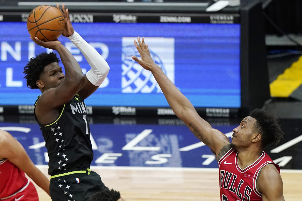 Minnesota Timberwolves forward Anthony Edwards, left, shoots against Chicago Bulls center Wendell Carter Jr., during the second half of an NBA basketball game in Chicago, Wednesday, Feb. 24, 2021. (AP Photo/Nam Y. Huh)