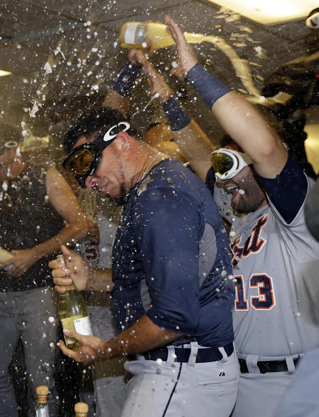 Detroit Tigers pitcher Joaquin Benoit celebrates in the locker room after the Tigers beat the Oakland Athletics 3-0 to win Game 5 of an American League baseball division series in Oakland, Calif., Thursday, Oct. 10, 2013. (AP Photo/Ben Margot)