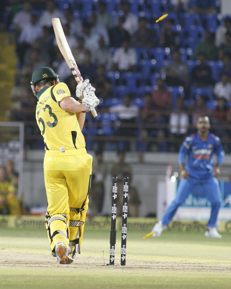 Australian batsman Nic Maddinson bowled by Indian bowler Bhuvneshwar Kumar during the T20 match between India and Australia in Rajkot on 10 October 2013. (Photo: IANS)