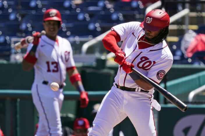 Washington Nationals' Josh Bell hits an RBI single during the first inning of a baseball game against the Miami Marlins at Nationals Park, Saturday, May 1, 2021, in Washington. (AP Photo/Alex Brandon)