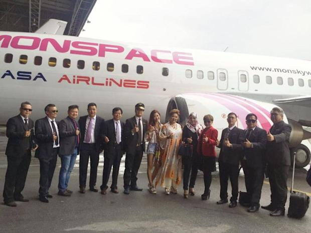 Maria Cordero (sixth from right) poses for a group photo with the staff of MonSpace Sky Airlines, July 24, 2016. — Picture courtesy of MariaCordero/Facebook