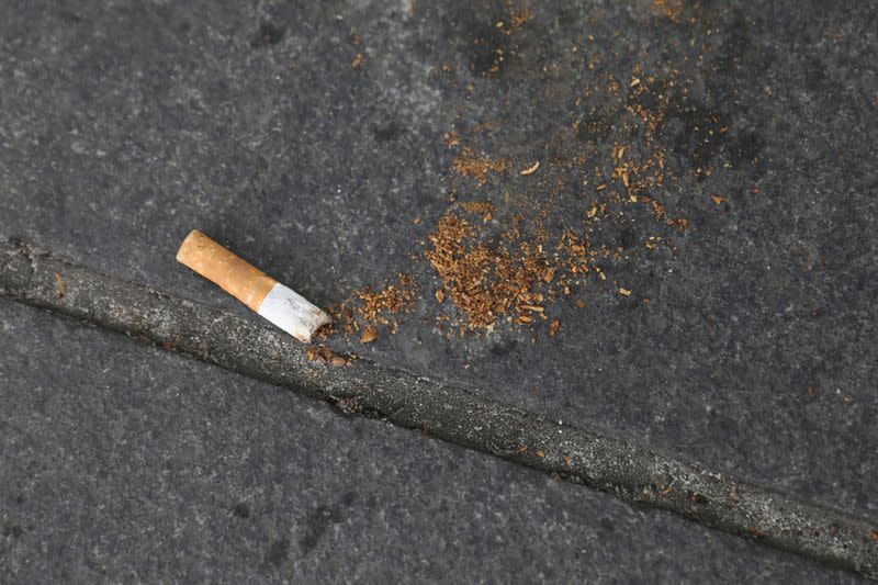 FILE PHOTO: A cigarette butt lies on a street in New York
