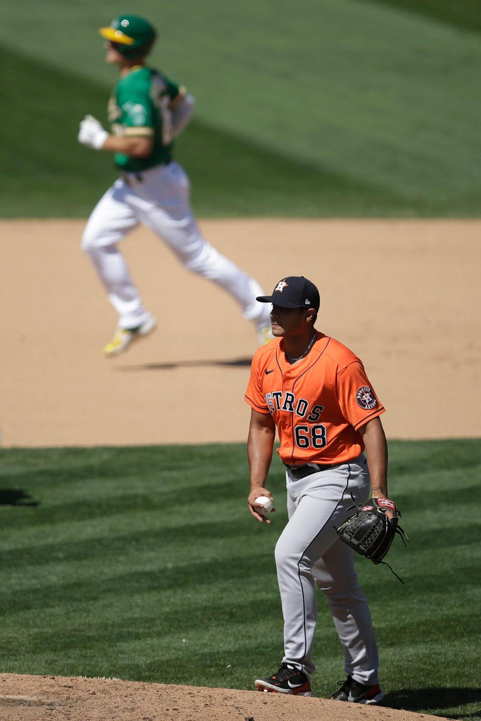 Houston Astros' Nivaldo Rodriguez (68) waits for Oakland Athletics' Matt Chapman to run the bases after hitting a home run in the eighth inning of a baseball game Saturday, Aug. 8, 2020, in Oakland, Calif. (AP Photo/Ben Margot)