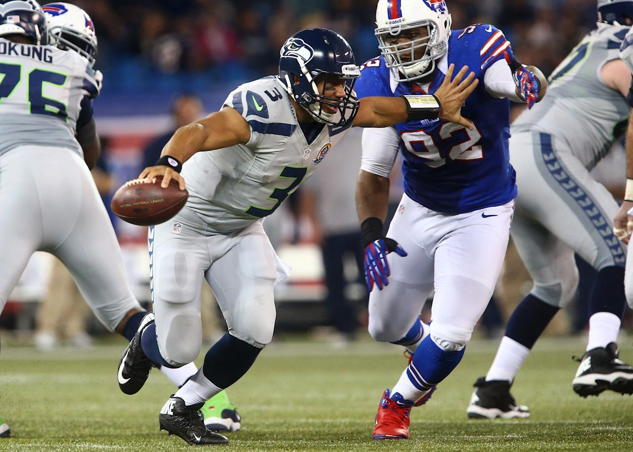 TORONTO, ON - DECEMBER 16: Russell Wilson #3 of the Seattle Seahawks is flushed out of the pocket during an NFL game by Alex Carrington #92 of the Buffalo Bills at Rogers Centre on December 16, 2012 in Toronto, Ontario, Canada. (Photo by Tom Szczerbowski/Getty Images)