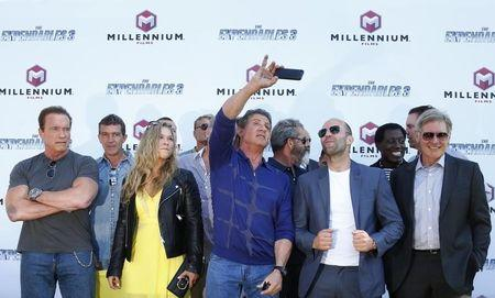 "(L-R) Cast members Arnold Schwarzenegger, Antonio Banderas, Ronda Rousey, Sylvester Stallone, Mel Gibson, Jason Statham, Wesley Snipes and Harrison Ford pose during a photocall on the Croisette to promote the film ""The Expendables 3"" during the 67th Cannes Film Festival in Cannes May 18, 2014. REUTERS/Yves Herman"