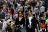 Unmasked: Pedestrians in downtown Nantes, western France, on Thursday