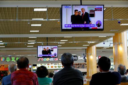 FILE PHOTO: People watch from a shopping mall food court in the Los Angeles neighborhood of Koreatown as Singapore hosted a summit between U.S. President Donald Trump and North Korean leader Kim Jong Un, in Los Angeles, California, U.S., June 11, 2018.  REUTERS/Mike Blake/Files