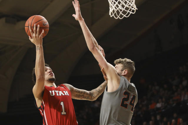 Oregon State's Kylor Kelley (24) tries to block a shot by Utah's Timmy Allen (1) during the first half of an NCAA college basketball game in Corvallis, Ore., Thursday, Feb. 13, 2020. (AP Photo/Amanda Loman)