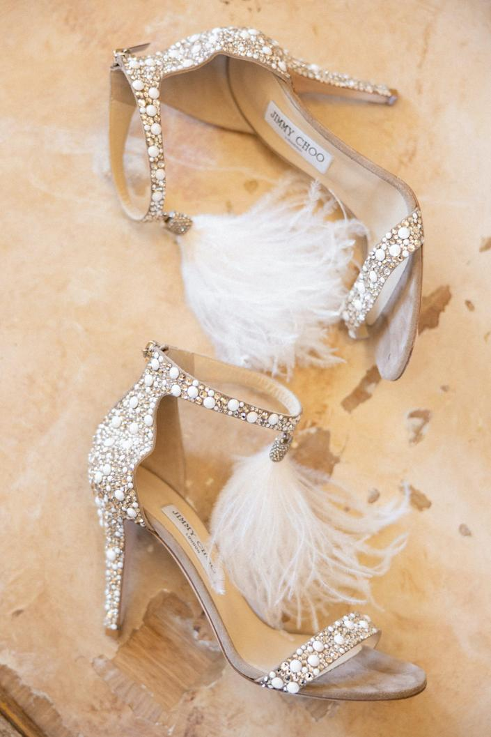 A pair of sparkly, feathered high heels