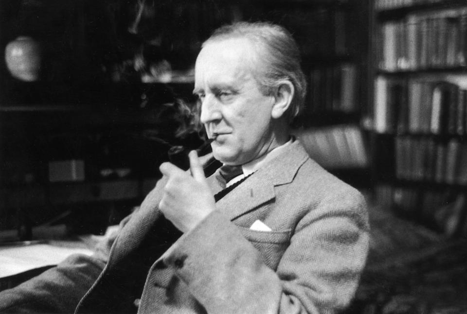 J.R.R. Tolkien enjoying a pipe in his study at Merton College, Oxford in 1955. (Photo by Haywood Magee/Picture Post/Hulton Archive/Getty Images)