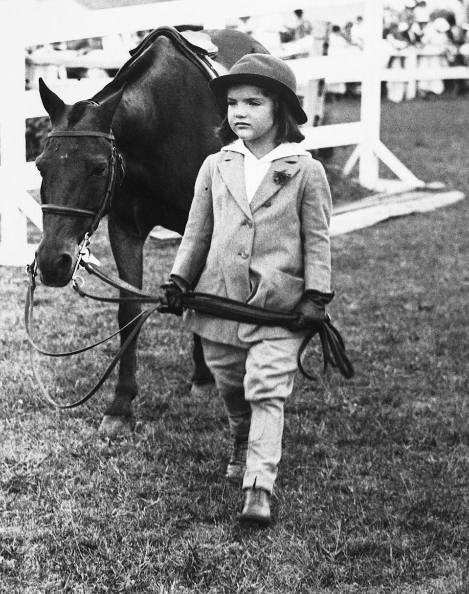 <p>A young Jaqueline Kennedy (née Bouvier), leading a pony at a Southampton horse show. </p>