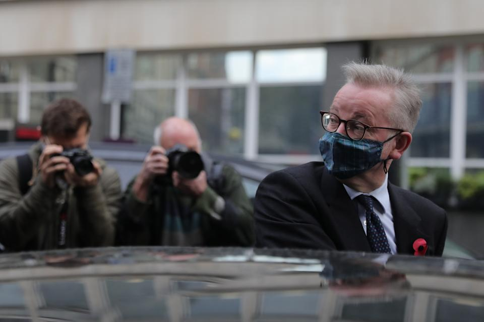 Chancellor of the Duchy of Lancaster Michael Gove wears a face mask as he leaves a branch of Pret A Manger in Westminster, London.