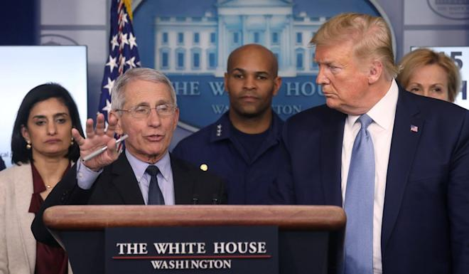 US President Donald Trump listens as Anthony Fauci, director of the National Institute of Allergy and Infectious Diseases, speaks about the outbreak at the White House on Monday. Photo: Reuters