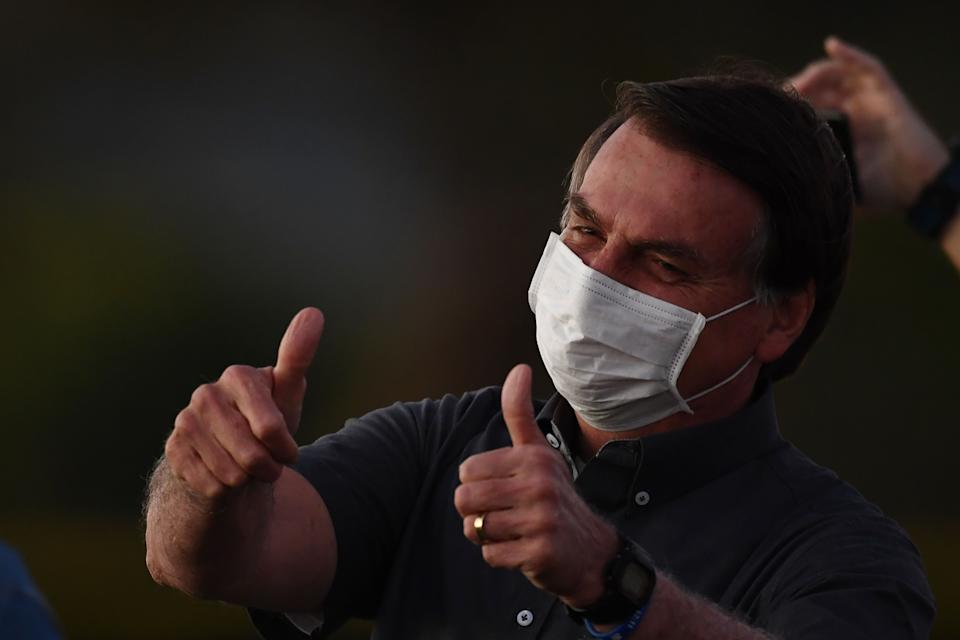 Brazilian President Jair Bolsonaro gives the thumbs up to supporters.