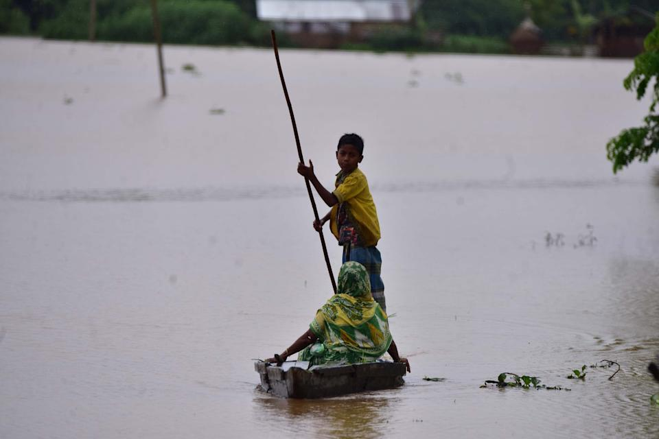 NAGAON,INDIA-JULY 22,2020 :Flood affected villagers are transported on a boat towards a safer place at a village in Nagaon district of Assam , India - PHOTOGRAPH BY Anuwar Ali Hazarika / Barcroft Studios / Future Publishing (Photo credit should read Anuwar Ali Hazarika/Barcroft Media via Getty Images)