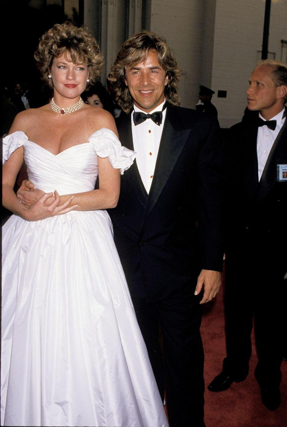 <p>The actress glowed in a white off-the-shoulder ballgown and pearl choker alongside then husband Don Johnson. She was nominated for Best Actress in the film <em>Working Girl</em>. </p>