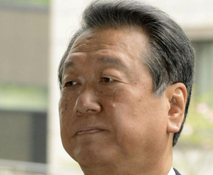 Ichiro Ozawa, a powerbroker of the ruling Democratic Party of Japan, enters the Tokyo District Court in Tokyo Thursday, April 26, 2012. The court acquitted the veteran lawmaker Thursday in a political funding scandal. Ozawa was charged last year with overseeing false accounting by his former aides in a murky 2004 land deal. (AP Photo/Kyodo News) JAPAN OUT, MANDATORY CREDIT, NO LICENSING IN CHINA, HONG KONG, JAPAN, SOUTH KOREA AND FRANCE