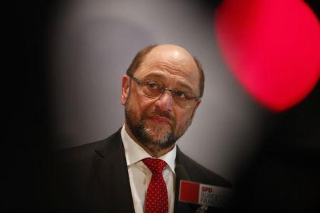 Former European Parliament president Martin Schulz addresses the media after a Social Democratic Party SPD parliamentary fraction meeting in Berlin, Germany, January 25, 2017. REUTERS/Fabrizio Bensch