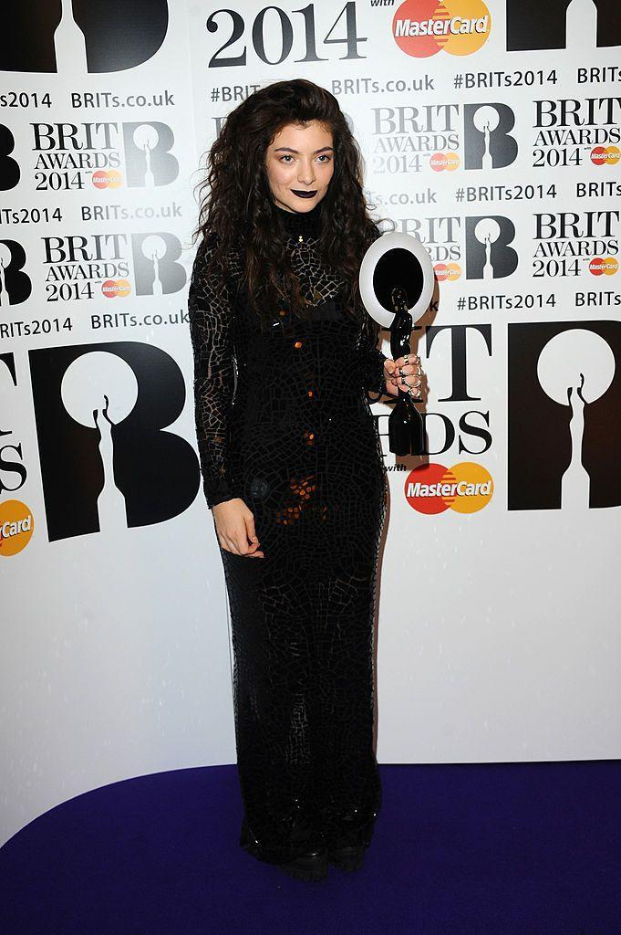 """<p>Lorde won the 'International Female Artist' prize in 2014 and wore a <a href=""""https://www.elle.com/uk/fashion/celebrity-style/articles/g3604/10-best-dressed-at-the-brit-awards-2014/?"""" rel=""""nofollow noopener"""" target=""""_blank"""" data-ylk=""""slk:gothic, high-neck Tom Ford dress"""" class=""""link rapid-noclick-resp"""">gothic, high-neck Tom Ford dress</a> for the occasion.</p>"""
