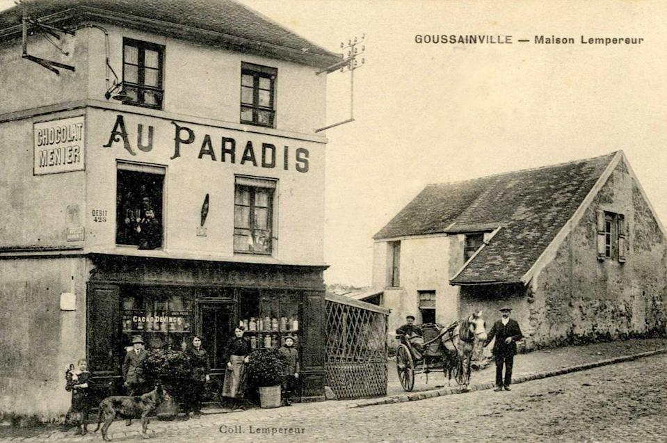 """A vintage postcard from 1915 shows the cafe """"Au Paradis"""" in its heyday. Punters pose outside the establishment and the facade is decorated with two potted plants. (Reuters)"""