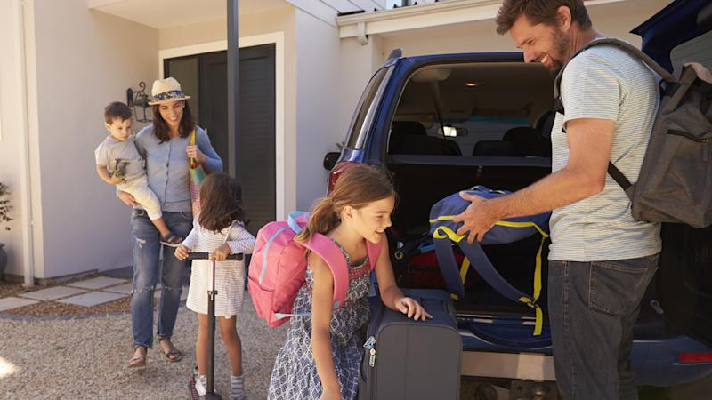 A family packing a car for a road trip