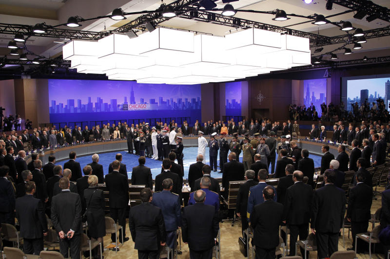 The NATO leaders gather as the opening session of the NATO Summit begins in Chicago, Sunday, May 20, 2012. (AP Photo/Christophe Ena)