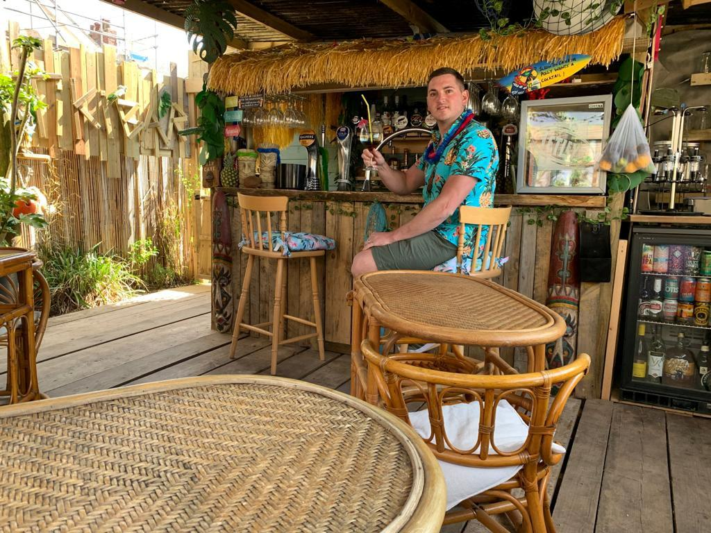 Tom Sherratt took a unique take on the lockdown garden pub and built his own tiki bar for just £800. (Tom Sherratt / SWNS.COM)