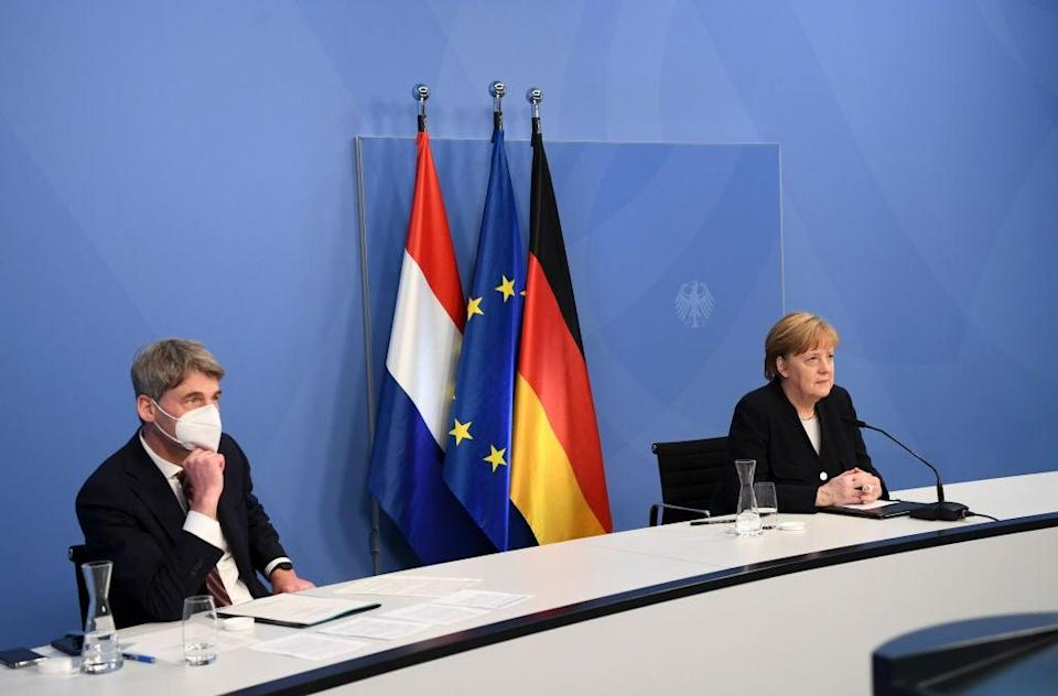 Jan Hecker with Angela Merkel at a virtual event with Dutch PM Mark Rutte marking Liberation Day, the end of the occupation by Nazi Germany during World War Two (Getty Images)