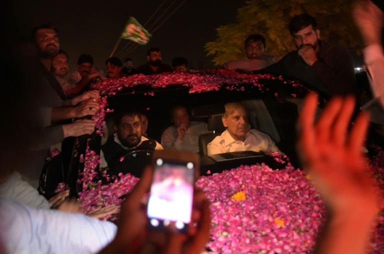 Former Pakistani prime minister Nawaz Sharif was driven away in an SUV as it was pelted with rose petals in celebration, with younger brother Shahbaz Sharif in the front seat of the vehicle